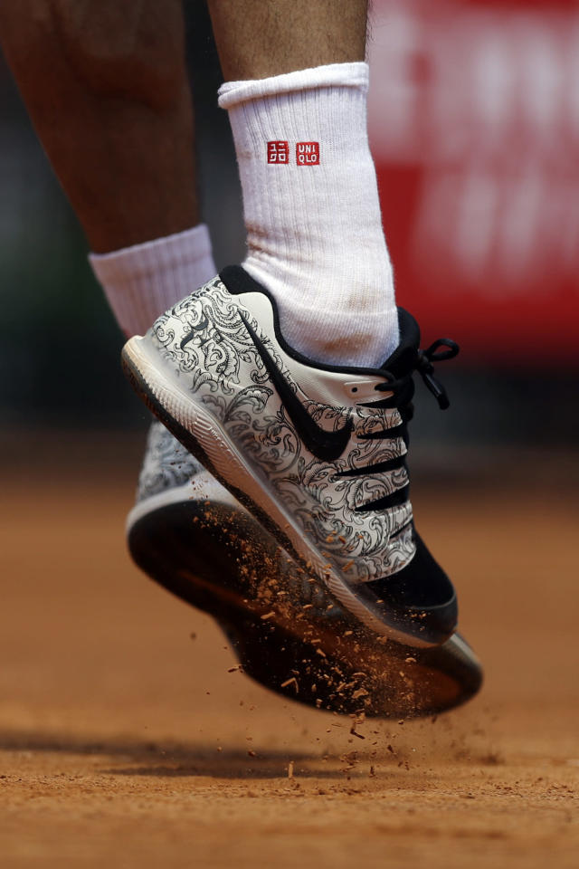 Switzerland's Roger Federer serves the ball during his match against Portugal's Joao Sousa at the Italian Open tennis tournament, in Rome, Thursday, May, 16, 2019. (AP Photo/Gregorio Borgia)