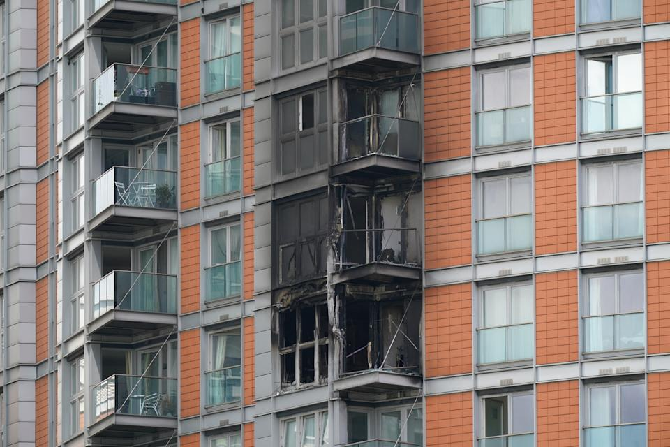 Damage to a 19-storey tower block in New Providence Wharf in London, where the London Fire Brigade (LFB) was called to on Friday morning to reports of a fire and more than 100 firefighters are tackling a blaze that has ripped through the block, believed to be covered in cladding, in east London. Picture date: Friday May 7, 2021. See PA story FIRE CanaryWharf. Photo credit should read: Yui Mok/PA