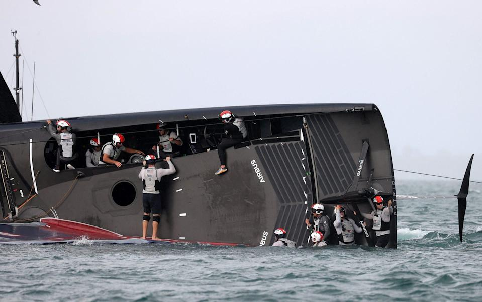 The crew of American Magic wait for help - Getty Images