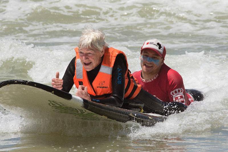 """""""To be in the water and to feel the movement again, it's really special,"""" says 75-year-old Pamela Hanford, who broke her neck in a surfing accident a year ago (AFP Photo/RODGER BOSCH)"""