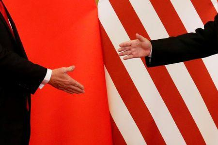 U.S. President Donald Trump and China's President Xi Jinping shake hands after making joint statements at the Great Hall of the People in Beijing, China, November 9, 2017.   REUTERS/Damir Sagolj/Files