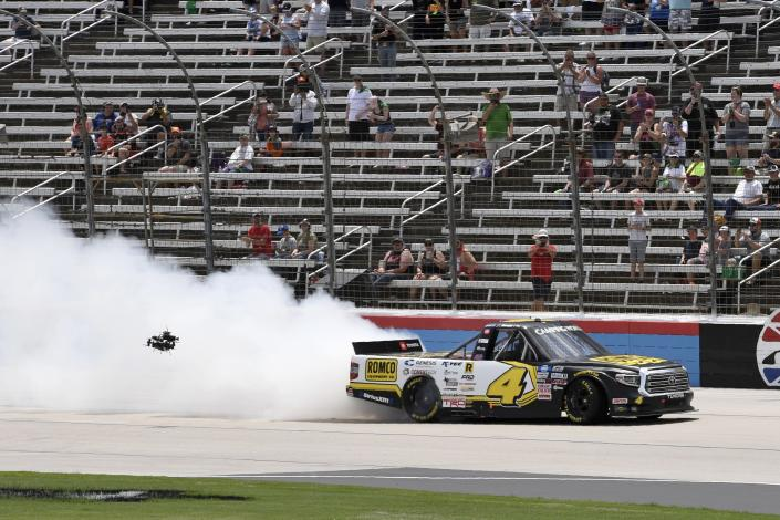 John Hunter Nemechek spins out on the front stretch after winning a NASCAR Truck Series auto race at Texas Motor Speedway in Fort Worth, Texas, Saturday, June 12, 2021. (AP Photo/Larry Papke)