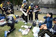 """""""They're so passionate about it. They all come here and they all watch and they make a day of it"""": Hard-working Filipino domestic helpers use their one day off a week in Hong Kong to play cricket"""