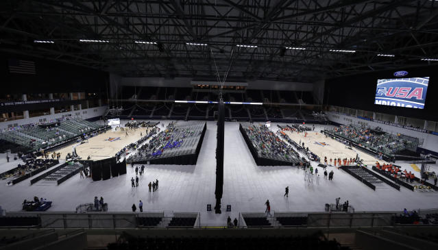 A general, overall view of Ford Center as Florida International University plays Southern Miss on Court A, at left, and University of Texas San Antonio plays University of Texas El Paso on Court B, at right, simultaneously on the first day of the men's and women's Conference USA basketball tournament in Frisco, Texas, Wednesday, March 7, 2018. (AP Photo/Tony Gutierrez)