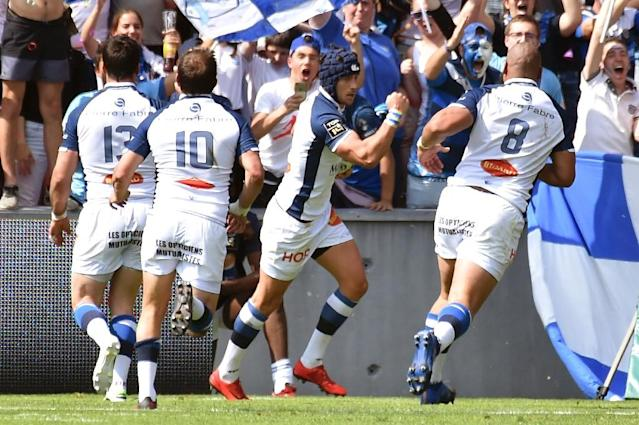 Man of the moment: Castres winger Armand Batlle celebrates one of his tries (AFP Photo/PASCAL PAVANI)