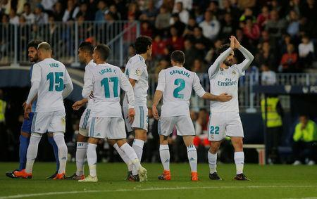 Soccer Football - La Liga Santander - Malaga CF vs Real Madrid - La Rosaleda, Malaga, Spain - April 15, 2018. Real Madrid's Isco celebrates scoring their first goal with team mates. REUTERS/Jon Nazca