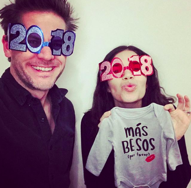 """<p>The actress/activist and her husband, actor and director Ryan Piers Williams, took to Instagram to make it official: They're expecting! """"We're welcoming one more face to kiss in 2018,"""" Ferrara wrote alongside a photo in which she's holding a onesie that reads, """"Mas Besos (Por Favor)."""" Translation? More kisses, please! (Photo: <a rel=""""nofollow noopener"""" href=""""https://www.instagram.com/p/BdYzBNLDeta/?hl=en&taken-by=americaferrera"""" target=""""_blank"""" data-ylk=""""slk:America Ferrera via Instagram"""" class=""""link rapid-noclick-resp"""">America Ferrera via Instagram</a>) </p>"""