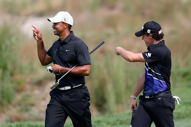 FARMINGDALE, NY - AUGUST 23: (L-R) Tiger Woods and Rory McIlroy of Northern Ireland share a laugh as they walk up the 18th hole fairway during the First Round of The Barclays on the Black Course at Bethpage State Park August 23, 2012 in Farmingdale, New York. (Photo by Kevin C. Cox/Getty Images)