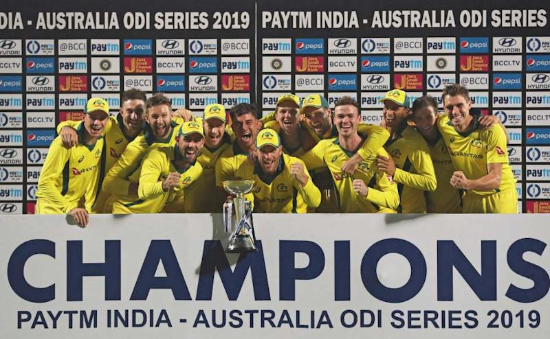Australia's players celebrate with the winning trophy after they win one day international series 2-3 against India in New Delhi, India, Wednesday, March 13, 2019. (AP Photo/Altaf Qadri)