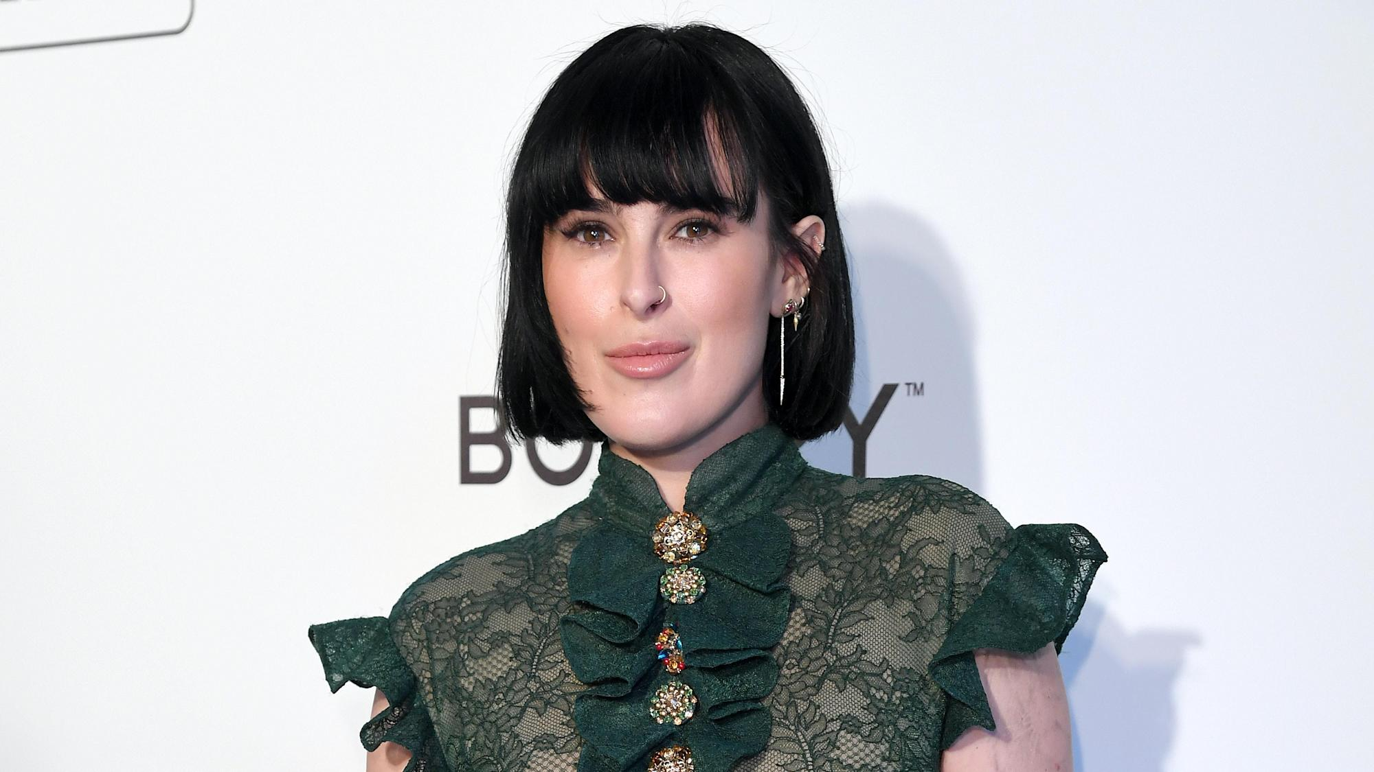 Rumer Willis urges fans to 'wear a damn mask' after Covid exposure
