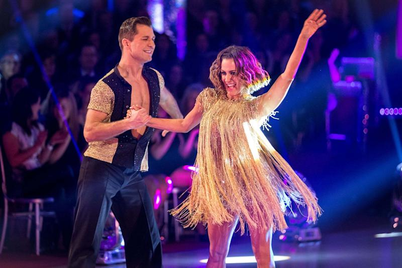 Caroline Flack and Pasha Kovalev perform on Strictly (PA)