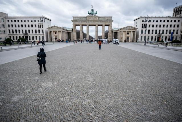 A nearly desolated Pariser Platz at the Brandenburg Gate in Berlin. (Michael Kappeler/DPA/Getty)