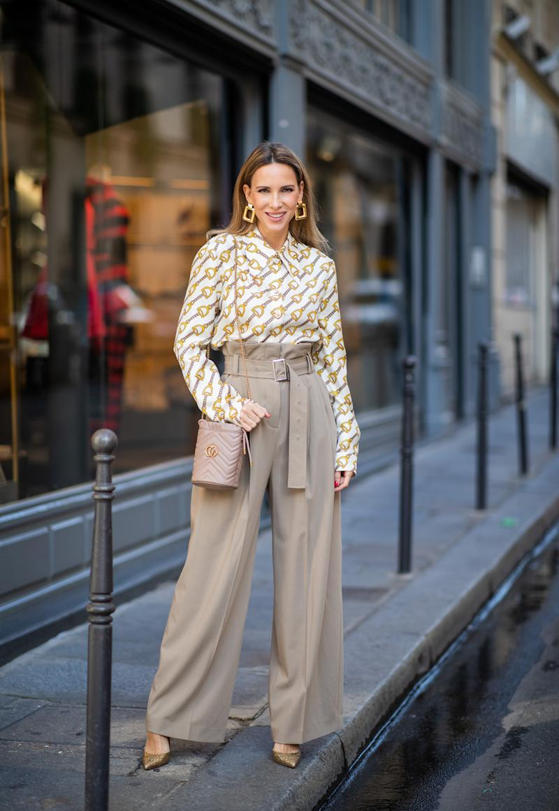 PARIS, FRANCE - SEPTEMBER 23: Alexandra Lapp is seen wearing printed Gucci blouse with oversized collar, beige Burberry paperbag pants with a high waist and broad belt detail, GG Marmont Mini-Bucket bag in nude, golden Christian Louboutin pumps during Paris Fashion Week Womenswear Spring Summer 2020 on September 23, 2019 in Paris, France. (Photo by Christian Vierig/Getty Images)