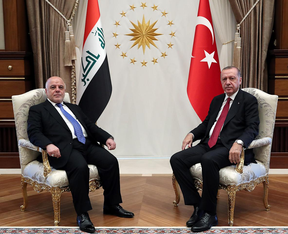 Turkish President Tayyip Erdogan meets with Iraqi Prime Minister Haider al-Abadi in Ankara, Turkey August 14, 2018. Kayhan Ozer/Presidential Palace/Handout via REUTERS ATTENTION EDITORS - THIS PICTURE WAS PROVIDED BY A THIRD PARTY. NO RESALES. NO ARCHIVE.
