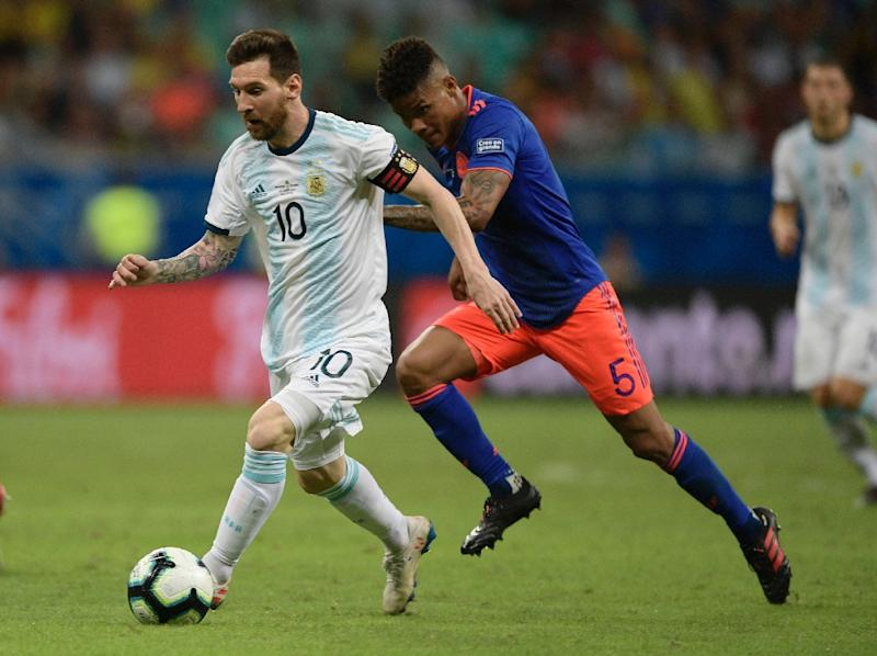 Wilmar Barrios (right) shadowed Argentina's superstar Lionel Messi throughout the match, never giving him time on the ball (AFP Photo/Juan MABROMATA)