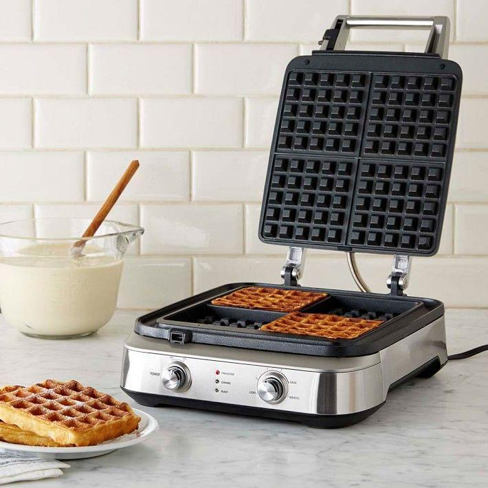 """<p>williams-sonoma.com</p><p><strong>$199.95</strong></p><p><a href=""""https://go.redirectingat.com?id=74968X1596630&url=https%3A%2F%2Fwww.williams-sonoma.com%2Fproducts%2Fbreville-smart-basic-waffle-maker&sref=https%3A%2F%2Fwww.redbookmag.com%2Flife%2Fg34761881%2Fgift-ideas-for-men%2F"""" rel=""""nofollow noopener"""" target=""""_blank"""" data-ylk=""""slk:Shop Now"""" class=""""link rapid-noclick-resp"""">Shop Now</a></p><p>Make breakfast on Saturday morning that much more fun with a waffle maker, complete with custom control dials. Can't you just smell that warm and toasty goodness already?</p><p><strong>More: </strong><a href=""""https://www.townandcountrymag.com/leisure/dining/g23937264/gourmet-food-gifts/"""" rel=""""nofollow noopener"""" target=""""_blank"""" data-ylk=""""slk:Gourmet Food Gifts"""" class=""""link rapid-noclick-resp"""">Gourmet Food Gifts</a></p>"""