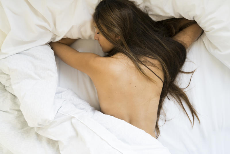 Experts warn that sleeping in the nude will make you hotter than sleeping in pyjamas. [Photo: Getty]