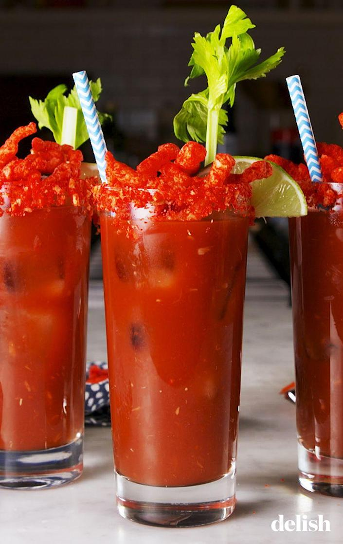 "<p>A Cheetos-inspired Bloody Mary? We're sold. </p><p>Get the recipe from <a href=""https://www.delish.com/cooking/recipe-ideas/a26079810/flamin-hot-bloody-marys-recipe/"" rel=""nofollow noopener"" target=""_blank"" data-ylk=""slk:Delish"" class=""link rapid-noclick-resp"">Delish</a>.</p>"