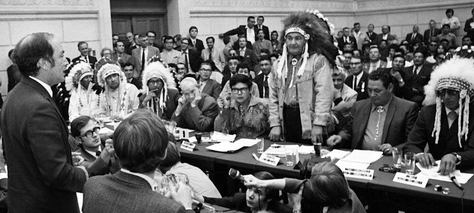 """<span class=""""caption"""">Prime Minister Pierre Trudeau speaks during a dramatic meeting with the entire federal cabinet and a delegation of about 200 First Nations leaders on Parliament Hill in Ottawa in 1970.</span> <span class=""""attribution""""><span class=""""source"""">THE CANADIAN PRESS/R. Mac </span></span>"""