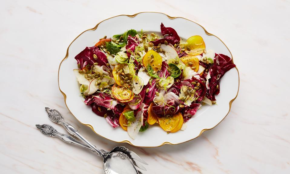 """Trimming a generous amount of the stem from the brussels sprouts makes it quite a bit easier to tease apart the leaves for this winter slaw recipe. <a href=""""https://www.bonappetit.com/recipe/winter-slaw-with-red-pears-and-pumpkin-seeds?mbid=synd_yahoo_rss"""" rel=""""nofollow noopener"""" target=""""_blank"""" data-ylk=""""slk:See recipe."""" class=""""link rapid-noclick-resp"""">See recipe.</a>"""