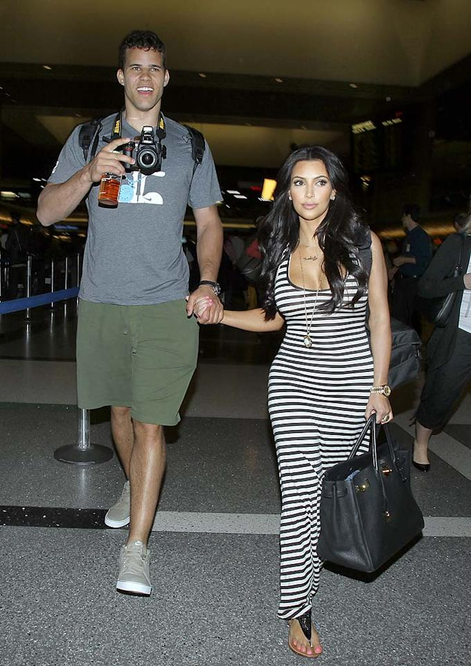 """Kim Kardashian cheated on her fiance Kris Humphries with NFL player Bret Lockett, reveals <i>In Touch</i> magazine, which scored an exclusive interview with Lockett himself. According to Lockett, he and Kardashian shared """"sexy texts"""" and had """"phone sex"""" over the course of several months, long after she and Humphries began dating. For how Kardashian is dealing with Lockett's bombshell about their """"secret fling,"""" and how it could threaten Kardashian's impending marriage, log on to <a href=""""http://www.gossipcop.com/kim-kardashian-cheating-bret-lockett-texts-phone-sex-sexting- kris-humphries/"""" target=""""new"""">Gossip Cop</a>. <a href=""""http://www.splashnewsonline.com"""" target=""""new"""">Splash News</a> - April 28, 2011"""