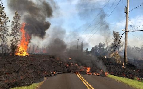 <span>Lava from a fissure slowly advancing to the northeast on Hookapu Street in Leilani Estates, Hawaii</span> <span>Credit: US Geological Survey/HO/AFP Photo </span>