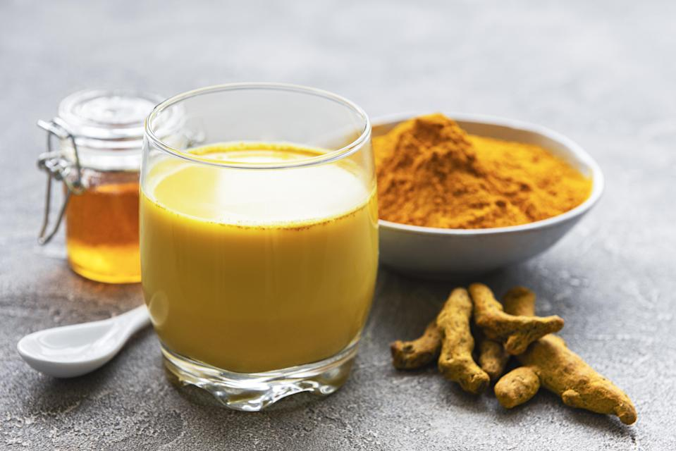 """<p>You may have seen something called a """"golden milk latte"""" at your local coffee shop recently and wondered what the fuss was about. It's steamed milk mixed with turmeric, sometimes ground ginger and ground cinnamon and honey. The drink is nothing new for South Asian households who have been drinking """"haldi doodh,"""" or """"turmeric milk,"""" for centuries <a href=""""https://www.theactivetimes.com/sniffles-not-just-a-cold?referrer=yahoo&category=beauty_food&include_utm=1&utm_medium=referral&utm_source=yahoo&utm_campaign=feed"""" rel=""""nofollow noopener"""" target=""""_blank"""" data-ylk=""""slk:to treat colds and sore throats"""" class=""""link rapid-noclick-resp"""">to treat colds and sore throats</a>. It's sweet, earthy and deliciously calming, and you don't need to drop $5 on it.</p> <p><a href=""""https://www.thedailymeal.com/recipes/turmeric-latte-recipe?referrer=yahoo&category=beauty_food&include_utm=1&utm_medium=referral&utm_source=yahoo&utm_campaign=feed"""" rel=""""nofollow noopener"""" target=""""_blank"""" data-ylk=""""slk:For the Turmeric Latte recipe, click here."""" class=""""link rapid-noclick-resp"""">For the Turmeric Latte recipe, click here.</a> </p>"""