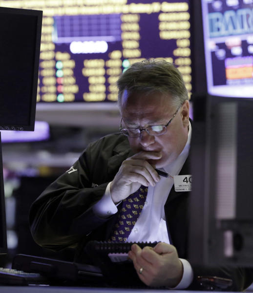 Trader Michael Iervoline works on the floor of the New York Stock Exchange, Monday, June 10, 2013. The stock market is getting off to a mixed start as traders show only mild enthusiasm for an improving outlook for the U.S. government's credit rating. (AP Photo/Richard Drew)