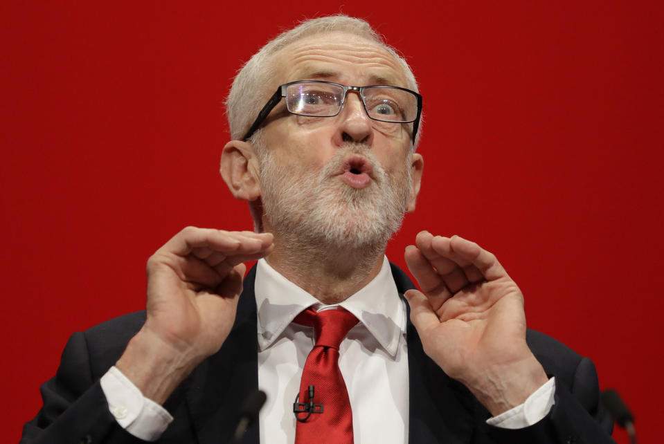 Jeremy Corbyn, leader of Britain's opposition Labour Party addresses party members during the Labour Party Conference at the Brighton Centre in Brighton, England, Tuesday, Sept. 24, 2019. (AP Photo/Kirsty Wigglesworth)
