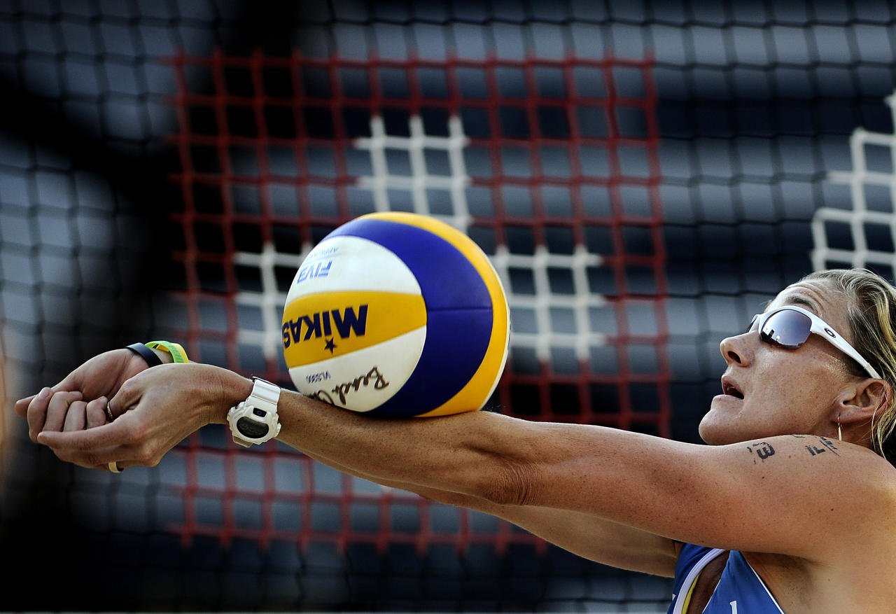 US Kerri Walsh receives the ball during the FIVB Beach Volleyball World Championships in Rome's Foro Italico, on June 18, 2011.   AFP PHOTO / Filippo MONTEFORTE (Photo credit should read FILIPPO MONTEFORTE/AFP/Getty Images)