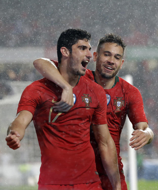 Portugal's Raphael Guerreiro, right, celebrates with Goncalo Guedes after he scored 3rd goal for his team during a friendly soccer match between Portugal and Algeria in Lisbon, Portugal, Thursday, June 7, 2018. (AP Photo/Armando Franca)