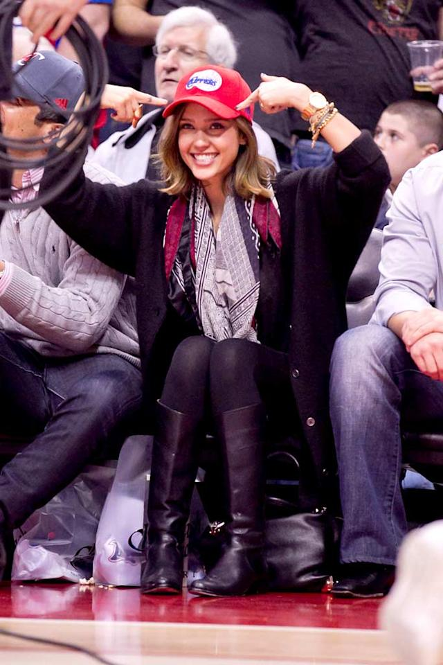 "Jessica Alba cheered on the L.A. Clippers Wednesday as they defeated the Miami Heat at the Staples Center in downtown Los Angeles 111-105. ""Great game #Clippers nino @Baron_Davis & Co played w heart n passion. Awesome Game!"" tweeted Alba after her team's exciting victory. London Entertainment/<a href=""http://www.splashnewsonline.com"" target=""new"">Splash News</a> - January 12, 2011"