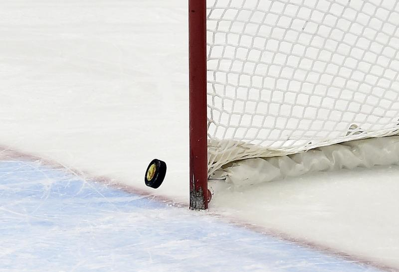The puck hits the post with Canada's goalie pulled in the last minutes of the third period of the gold-medal women's hockey game between Canada and the United States at the Sochi Winter Olympics in Sochi, Russia, on Thursday, Feb. 20, 2014. Canada scored in the final minute of regulation, and won 3-2 in overtime. (AP Photo/The Canadian Press, Nathan Denette)