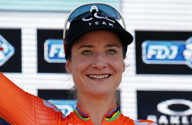 Marianne Vos, of the Netherlands celebrates on the podium after winning La Course by Le Tour de France, a women's cycling race, with start and finish in Pau, France, Friday, July 19, 2019. (AP Photo/Christophe Ena)