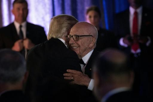 Analysts say it would be troublesome if mergers involving friends of Donald Trump such as Rupert Murdoch, seen with the president in 2017, are approved while those involving his adversaries are challenged