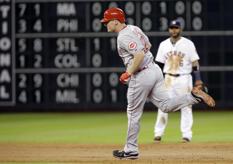 Cincinnati Reds' Jay Bruce rounds the bases after hitting a grand slam in the fourth inning of a baseball game Tuesday, Sept. 17, 2013, in Houston. (AP Photo/Pat Sullivan)