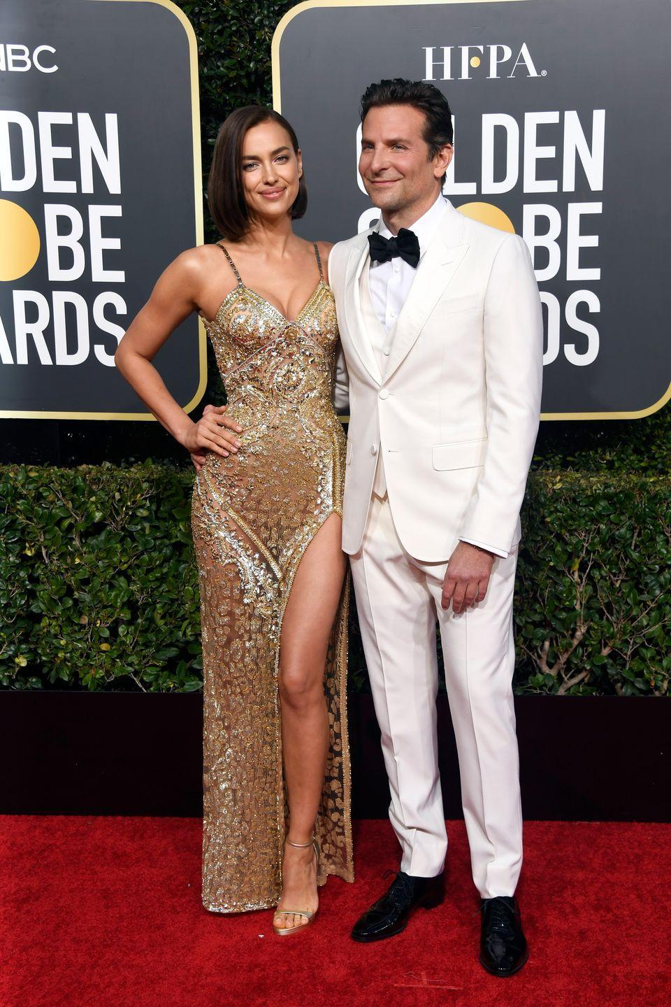 <p>All eyes were on Irina Shayk and Bradley Cooper at the 2019 Golden Globes—not only because of (false) rumors about Cooper and Lady Gaga but Shayk's stunning gilded Burberry dress with it's slit-up-to-there also gave onlookers something to talk about.</p>
