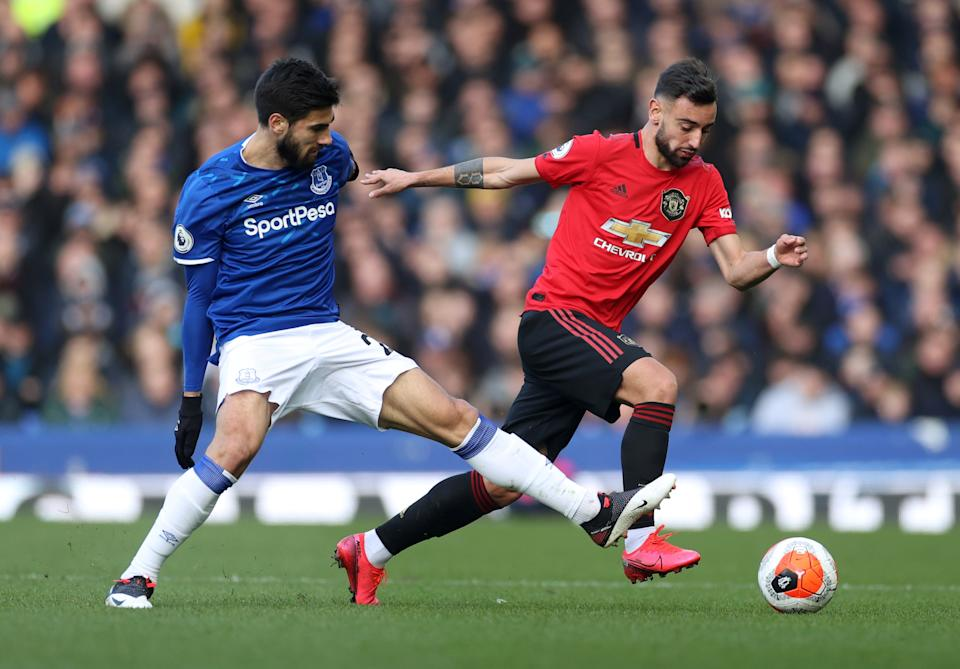 Manchester United's Bruno Fernandes (left) in action with Everton's Andre Gomes last season.