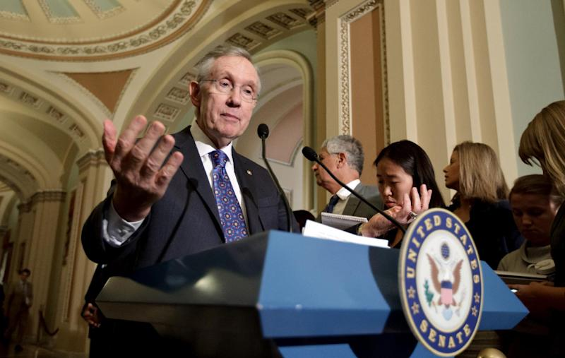 Senate Majority Leader Harry Reid of Nev. talks to reporters about the fight over extending tax cuts following a political strategy session, Tuesday, July 10, 2012, on Capitol Hill in Washington. (AP Photo/J. Scott Applewhite)