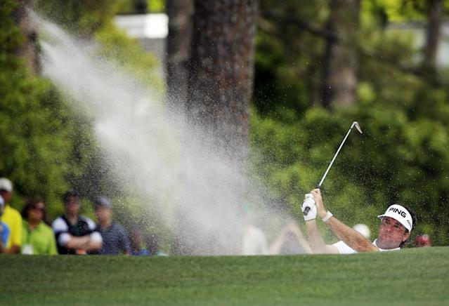Bubba Watson hits out of a bunker on the first fairway during the fourth round of the Masters golf tournament Sunday, April 13, 2014, in Augusta, Ga. (AP Photo/David J. Phillip)