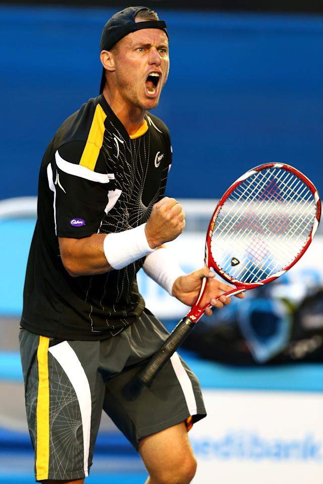 MELBOURNE, AUSTRALIA - JANUARY 14:  Lleyton Hewitt of Australia celebrates a point in hiserves first round match against Janko Tipsarevic of Serbia during day one of the 2013 Australian Open at Melbourne Park on January 14, 2013 in Melbourne, Australia.  (Photo by Ryan Pierse/Getty Images)