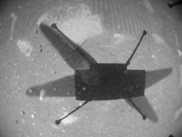 ingenuity helicopter shadow on martian ground black and white