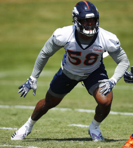 Denver Broncos linebacker Von Miller takes part in a drill during an NFL football minicamp session Tuesday, May 22, 2018, at the team's headquarters in Englewood, Colo.(AP Photo/David Zalubowski)