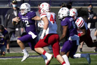 Northwestern quarterback Peyton Ramsey, left, runs with the ball against Nebraska during the first half of an NCAA college football game in Evanston, Ill., Saturday, Nov. 7, 2020. (AP Photo/Nam Y. Huh)