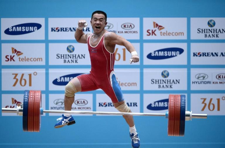 North Korea's Om Yun-Chol celebrates after breaking the world record in the men's 56kg weightlifting event during the 2014 Asian Games in Incheon