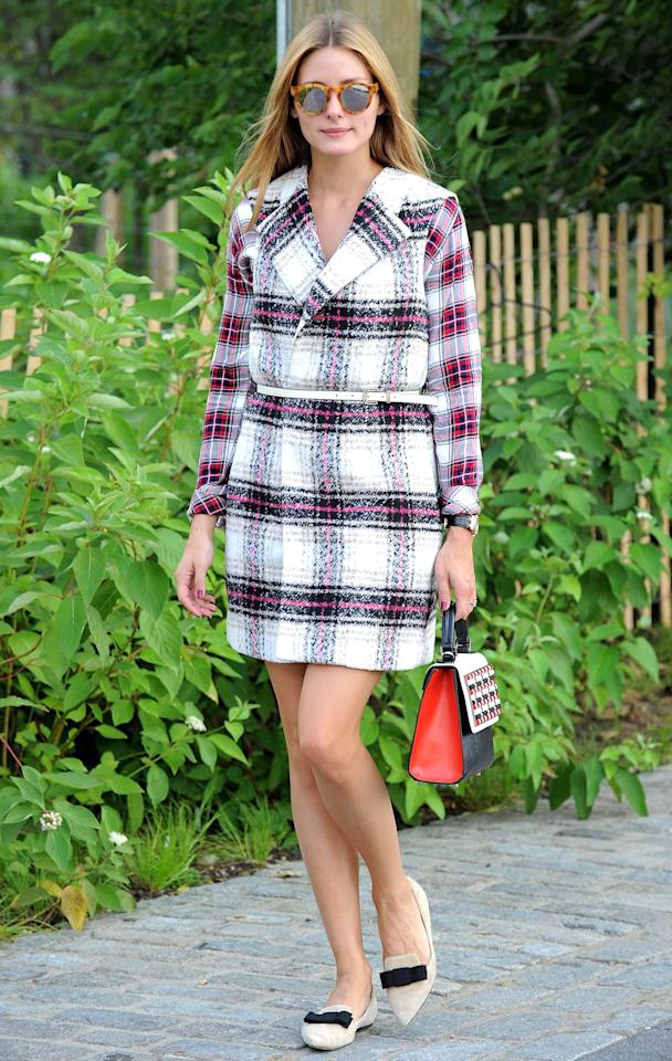 """<p>The street style star impressed with her creative layering of a plaid sleeveless coat over a plaid shirt (shop a similar style <a rel=""""nofollow"""" href=""""https://click.linksynergy.com/fs-bin/click?id=93xLBvPhAeE&subid=0&offerid=390098.1&type=10&tmpid=8157&RD_PARM1=http%253A%252F%252Fshop.nordstrom.com%252Fs%252Frails-hunter-plaid-shirt%252F4084037%253Forigin%253Dcategory-personalizedsort%2526fashioncolor%253DWHITE%25252F%252520INDIGO%25252F%252520BLUSH&u1=ISPlaidCelebIJMarch"""">here</a>). She added pointed toe flats with a bow detail, a skinny belt, structured bag, and mirrored sunnies to complete the look.</p>"""