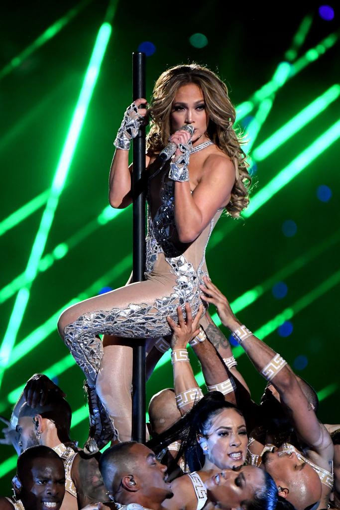 JLo donned a racy nude and chrome Versace catsuit [Photo: Getty]