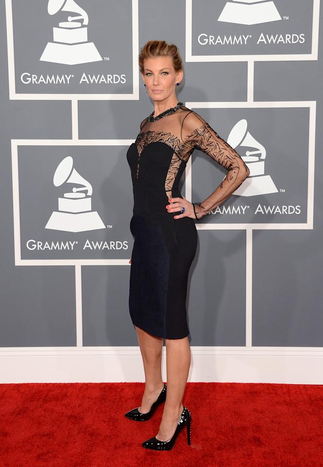 """<div class=""""caption-credit""""> Photo by: Getty</div><div class=""""caption-title""""></div>Despite looking a little too thin for comfort, Faith Hill rocked this chic and sophisticated J. Mendel dress. <br>"""