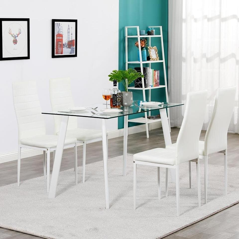 <p>This easy-to-assemble <span>Orren Ellis Tybee 4-Person Dining Set</span> ($240, originally $320) features a smooth surface that will make cleaning easier, as well as cushioned seats and a high-back design that ensure comfort.</p>