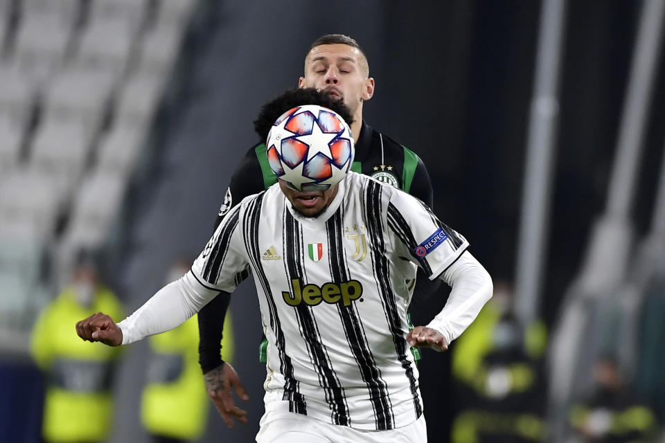 Juventus' Weston McKennie, foreground is challenged by Ferencvaros' Marcel Heister, during the Champions league, group G soccer match between Juventus and Ferencvaros, at the Allianz Stadium in Turin, Italy, Tuesday, Nov. 24, 2020. (Marco Alpozzi/LaPresse via AP)